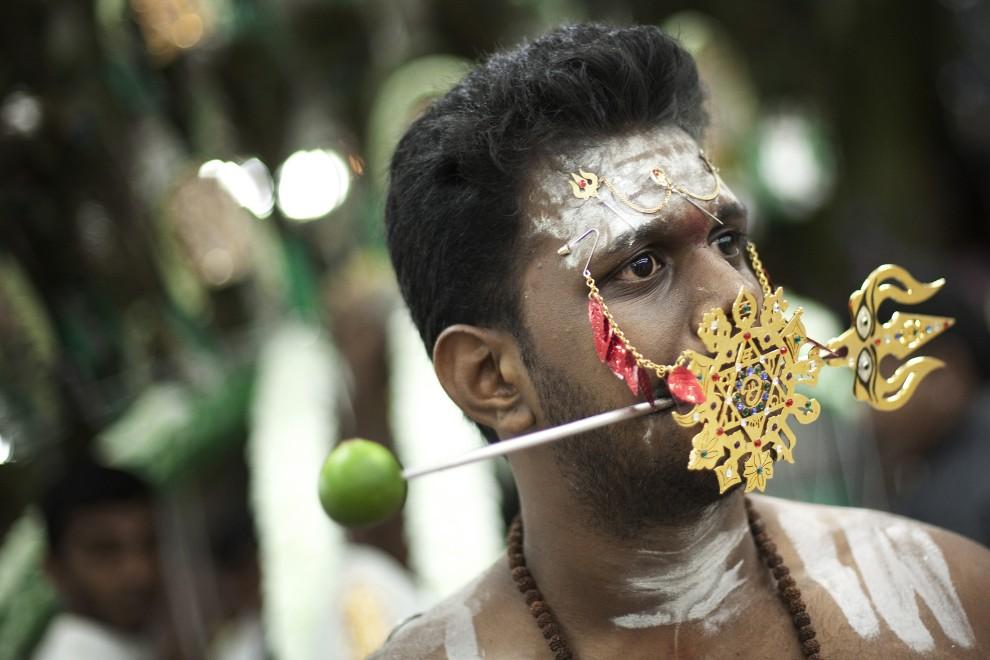 4. SINGAPUR, 20 stycznia 2011: Uczestnik procesji z okazji święta Thaipusam. (Foto: Chris McGrath/Getty Images)