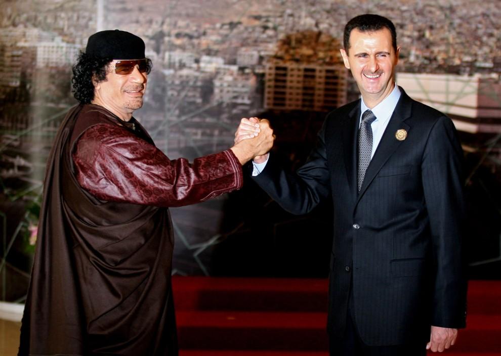 31. SYRIA, Damaszek, 29 marca 2008: Muammar al-Kaddafi  podczas spotkania z  prezydentem Syrii, Basharem al-Assadem. AFP PHOTO/HASSAN AMMAR