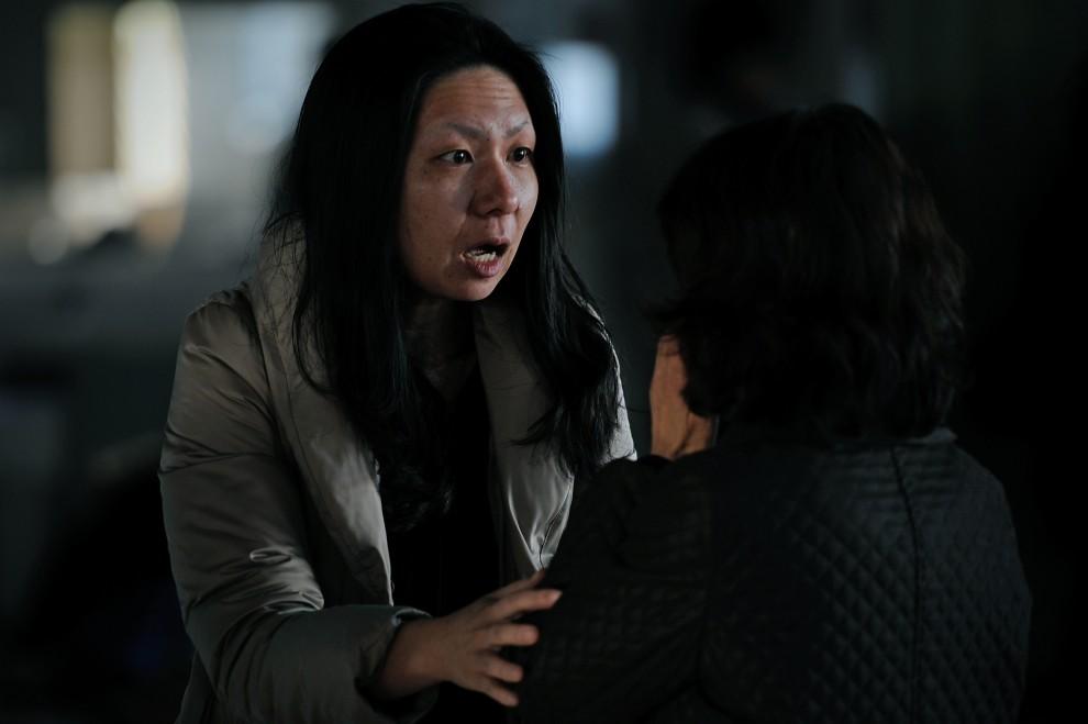22. JAPONIA, Sendai, 13 marca 2011: Kobiety, które spotkały się w schronisku dla ofiar kataklizmu. AFP PHOTO / Philippe Lopez