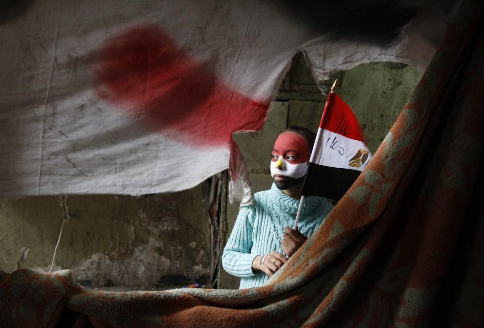 7. EGIPT, Kair, 7 lutego 2011: Dziewczynka, która uczestniczy w antyrządowych manifestacjach. AFP PHOTO/MOHAMMED ABED