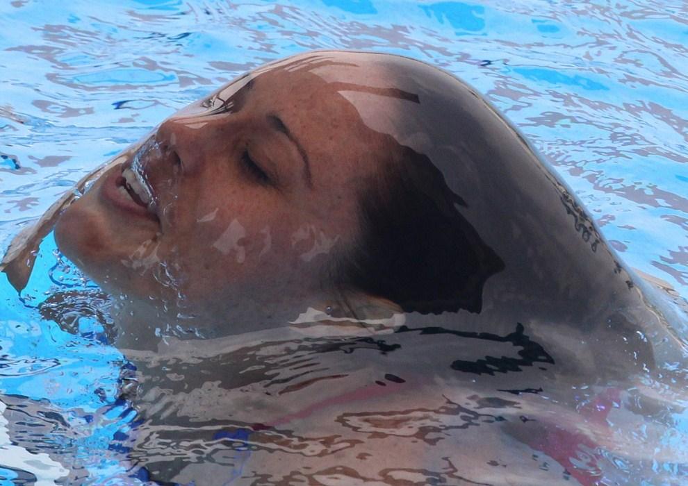 6. CHINY, Szanghaj, 22 lipca 2011: Hiszpnka Leyre Eizaguirre wynurza się po skoku na mistrzostwach świata w pływaniu. EPA/KIM LUDBROOK Dostawca: PAP/EPA