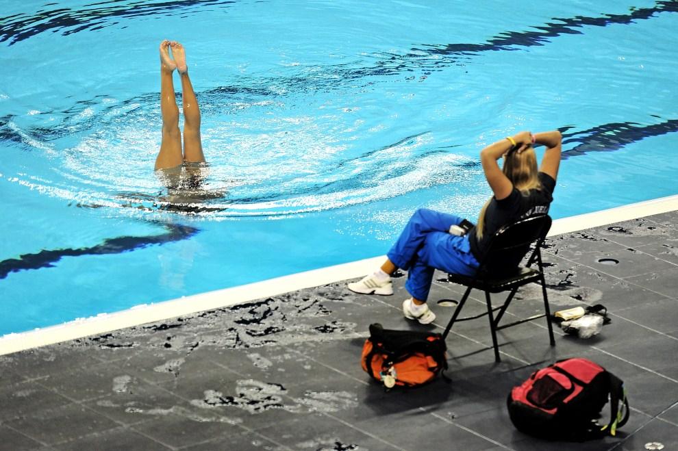 8. CHINY, Szanghaj, 13 lipca 2011: Trening reprezentacji Wenezueli w pływaniu synchronicznym. AFP PHOTO/Philippe Lopez