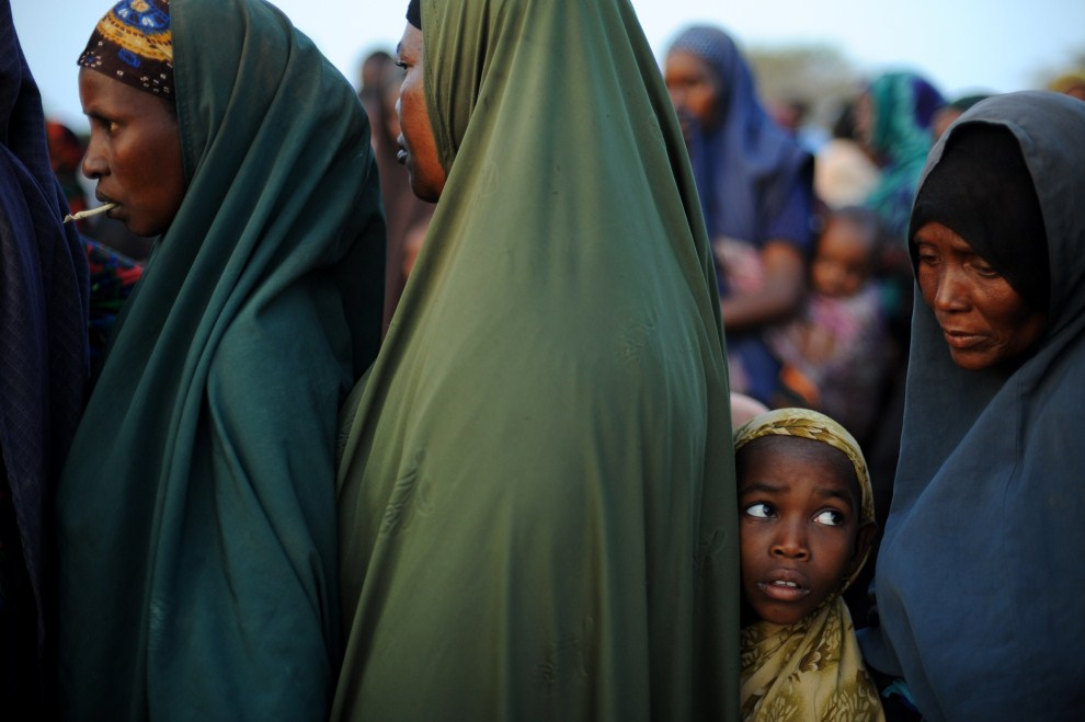 11th KENYA, Dadaab, 5 July 2011: The girl in the queue of women to the point of food distribution. AFP PHOTO / Roberto SCHMIDT