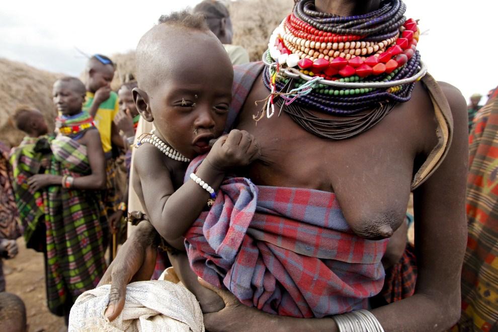 13th KENYA, Turkana, 11 August 2011: A child attempting to suck the breast of the mother. EPA / DAI Kurokawa Supplier: PAP / EPA.