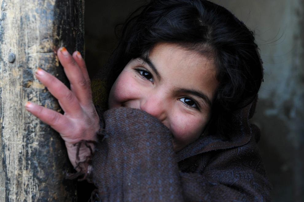 14.AFGANISTAN, Kabul, 17 stycznia 2012: Afganka na ulicy w centrum Kabulu. AFP PHOTO/ Qais Usyan