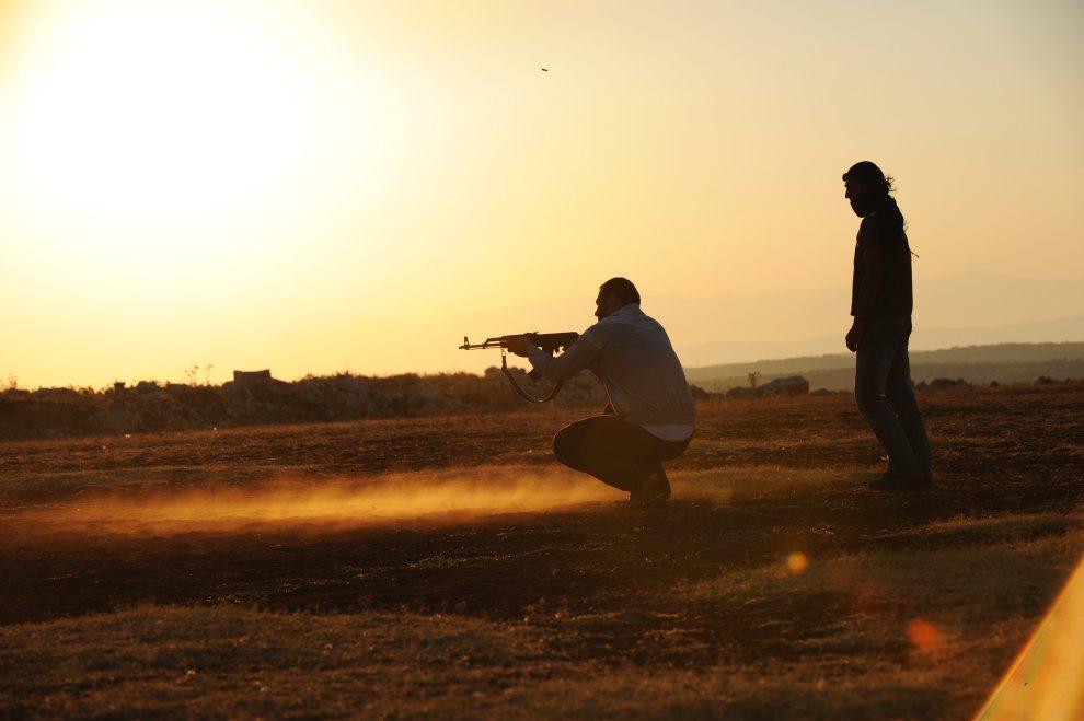 29.SYRIA, Aleppo, 19 lipca 2012: Uczestnicy obozu treningowego ugrupowania Hamza Abdualmuttalib. AFP PHOTO/BULENT KILIC