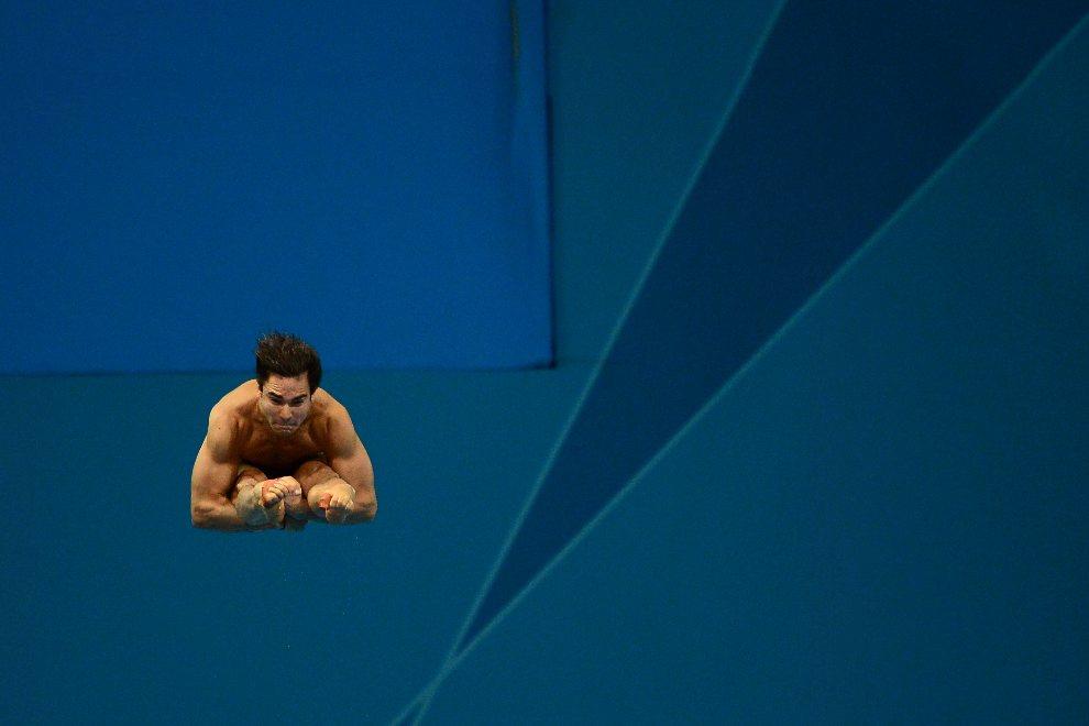 11.WIELKA BRYTANIA, Londyn, 7 sierpnia 2012: Alexandre Despatie (Kanada) w trakcie skoku do wody. AFP PHOTO / MARTIN BUREAU