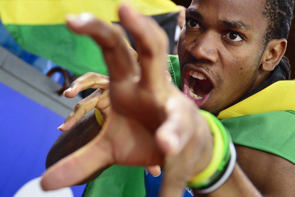 29.SZWAJCARIA, Zurich, 30 sierpnia 2012: Jamajczyk Yohan Blake cieszy się ze zwycięstwa w biegu na 100 m w czasie zawodów Diamentowej Ligii. AFP PHOTO/ FABRICE   COFFRINI