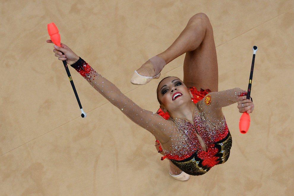 3.WIELKA BRYTANIA, Londyn, 11 sierpnia 2012: Gimnastyczka Jewgienija Kanajewa w trakcie występu na igrzyskach w Londynie. AFP PHOTO / ANTONIN THUILLIER