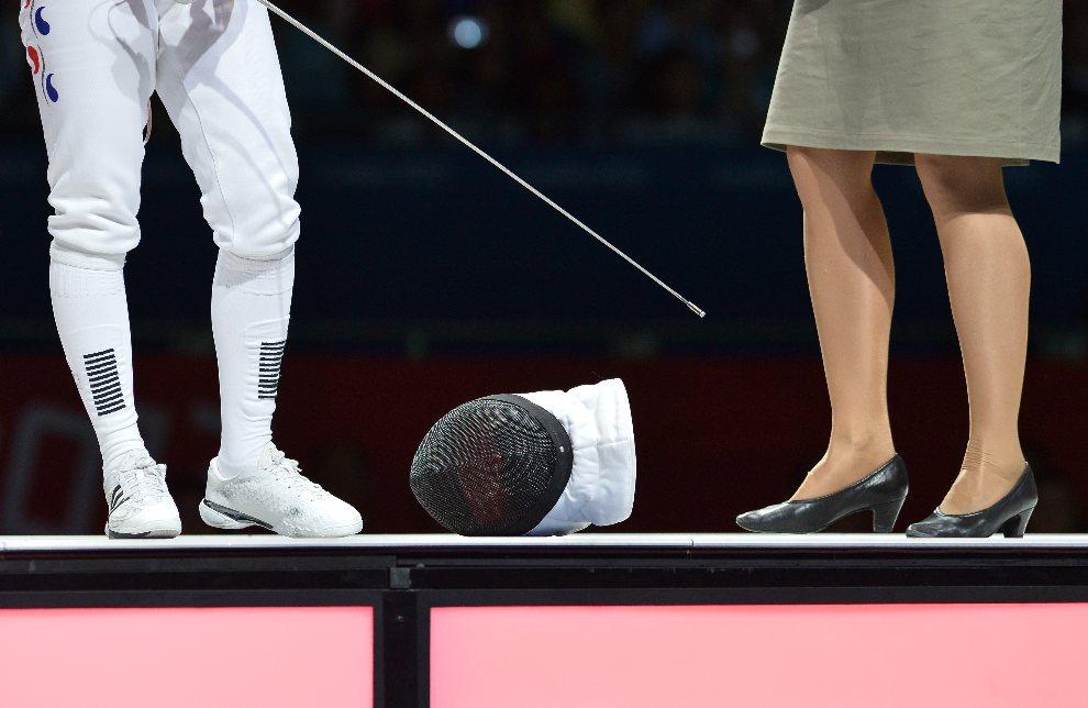 4.WIELKA BRYTANIA, Londyn, 30 lipca 2012: Shin A Lam (po lewej) w trakcie prezentacji przed pojedynkiem półfinałowym. AFP PHOTO / ALBERTO PIZZOLI