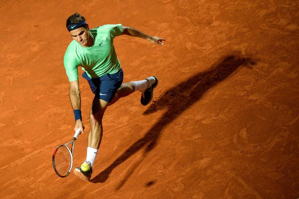 26.WŁOCHY, Rzym, 16 maja 2013: Roger Federer podczas meczu z Gilles'em Simonem. AFP PHOTO / ANDREAS SOLARO