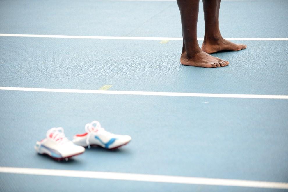 13.ROSJA, Moskwa, 18 sierpnia 2013: Usain Bolt po wygranym biegu w sztafecie 4x100 metrów. AFP FOTO:  / KIRILL KUDRYAVTSEV