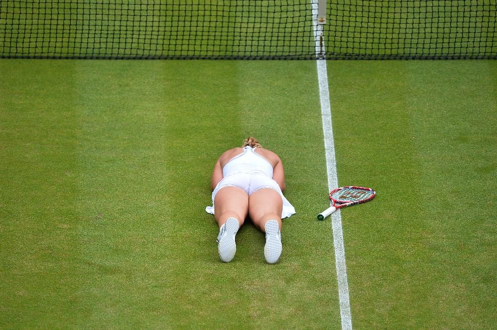 14.WIELKA BRYTANIA, Wimbledon, 1 lipca 2013: Sabine Lisicki cieszy się ze zwycięstwa nad Sereną Williams. AFP FOTO:  / BEN STANSALL - RESTRICTED TO EDITORIAL USE