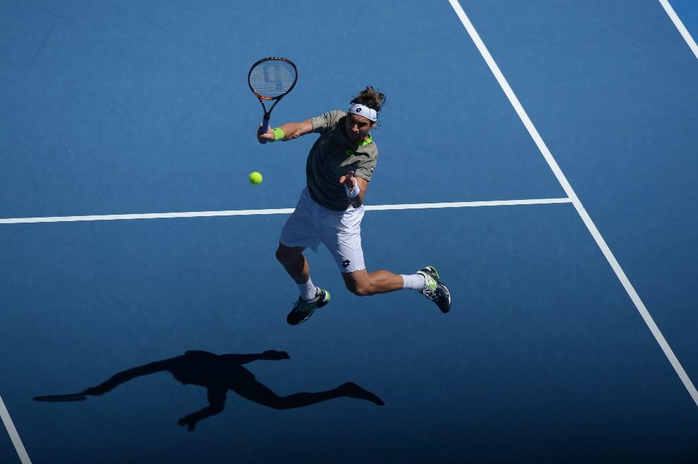 26.AUSTRALIA, Melbourne, 13 stycznia 2014: David Ferrer podczas pojedynku z Alejandro Gonzalesem. AFP PHOTO / GREG WOOD