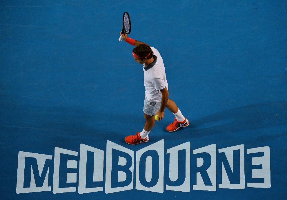 27.AUSTRALIA, Melbourne, 16 stycznia 2014: Roger Federer na korcie w Melbourne. AFP PHOTO / SAEED KHAN