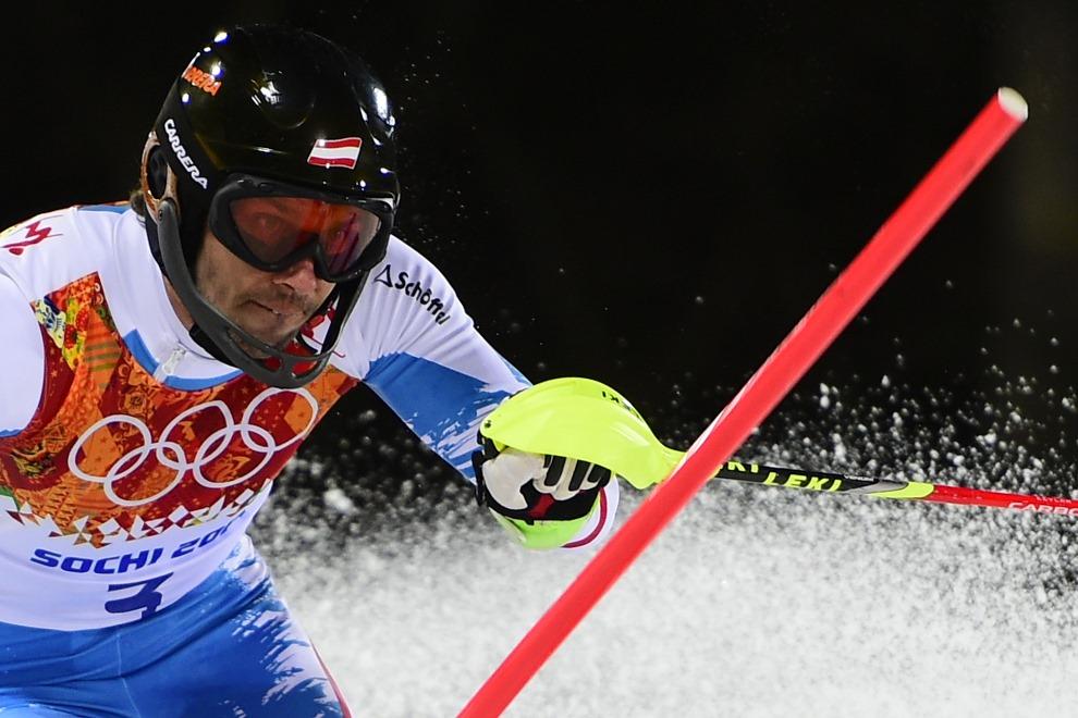4.ROSJA, Krasna Polana, 22 lutego 2014: Mario Matt podczas drugiego przejazdu na trasie slalomu. AFP PHOTO / FABRICE COFFRINI