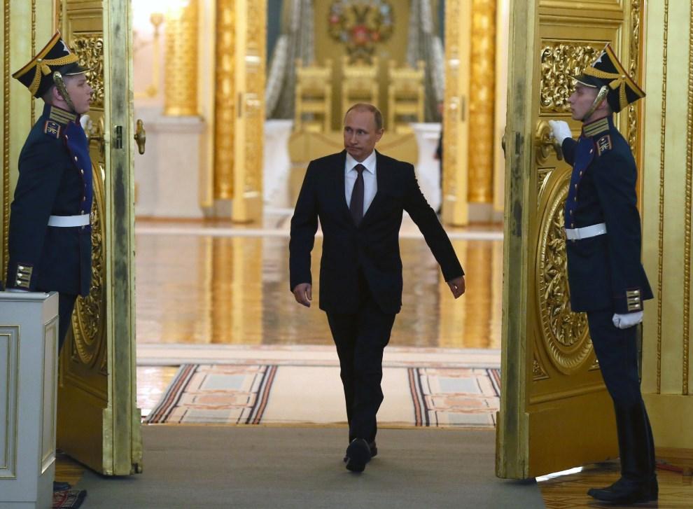 22.ROSJA, Moskwa, 18 marca 2014: Władimir Putin przed ogłoszeniem aneksji Krymu do Rosji. AFP PHOTO/ POOL/ SERGEI ILNITSKY
