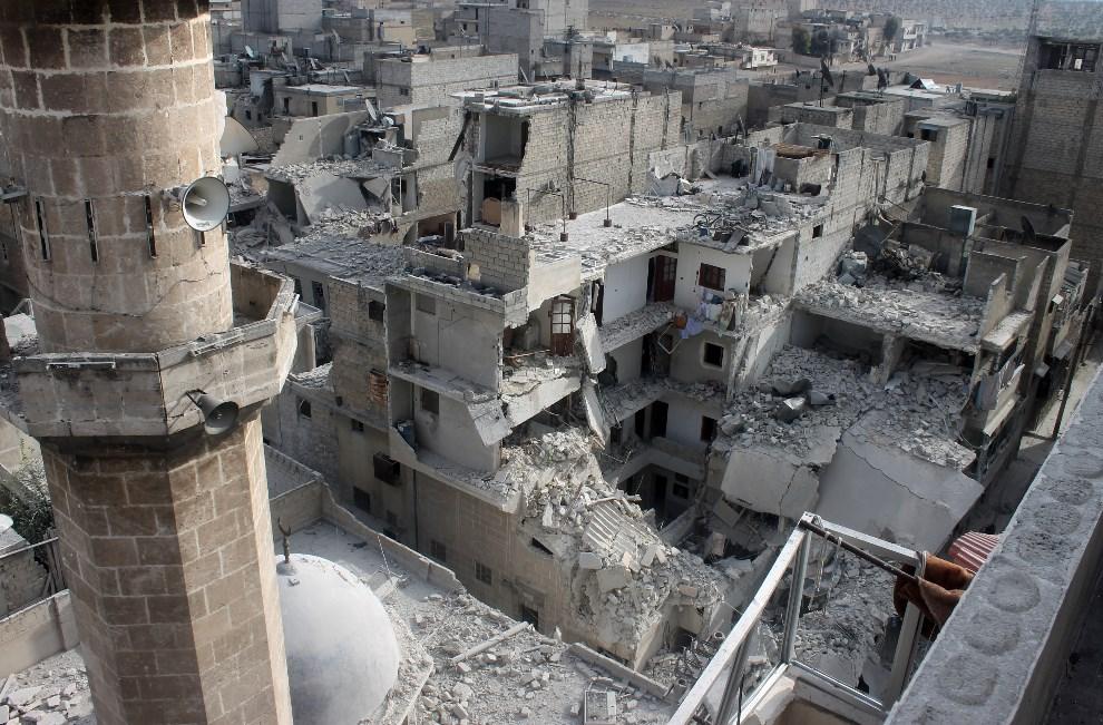23.SYRIA, Aleppo, 19 stycznia 2014: Budynki zniszczone w wyniku nalotu wojsk rządowych. AFP PHOTO MOHAMMED WESAM