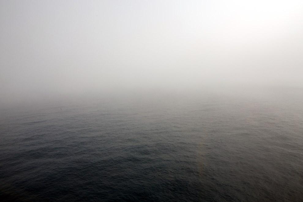 39.OCEAN INDYJSKI, 25 marca 2014: Ocean Indyjski widziany z pokładu nisko lecącego samolotu AP-3C Orion. AFP PHOTO / POOL / RICHARD WAINWRIGHT