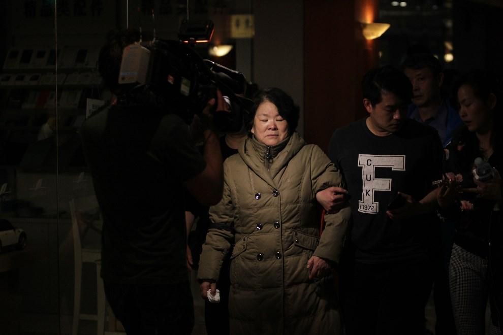 3.CHINY, Pekin, 24 marca 2014: Rodziny pasażerów zaginionego samolotu malezyjskich linii lotniczych. (Foto: ChinaFotoPress/Getty Images)