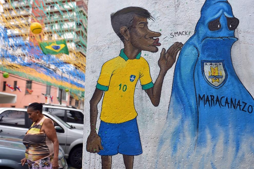 11.BRAZYLIA, Rio de Janeiro, 10 czerwca 2014: Mural z podobizną Neymara, nawiązujący do spotkania Brazylia-Urugwaj z 1950 roku. AFP PHOTO/ GABRIEL BOUYS