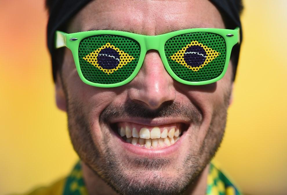1.BRAZYLIA, Sao Paulo, 12 czerwca 2014: Brazylijski kibic podczas ceremonii otwarcia. (Foto: Christopher Lee/Getty Images)