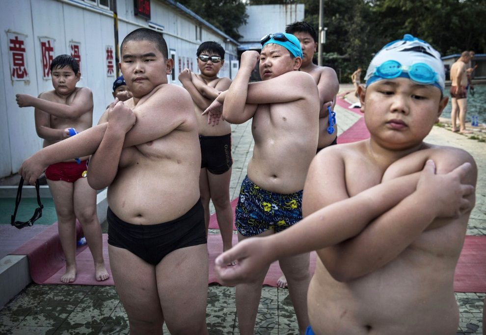 14.CHINY, Pekin, 15 lipca 2014: Dzieci uczestniczące w zajęciach na obozie dla osób z nadwagą. (Foto: Kevin Frayer/Getty Images)