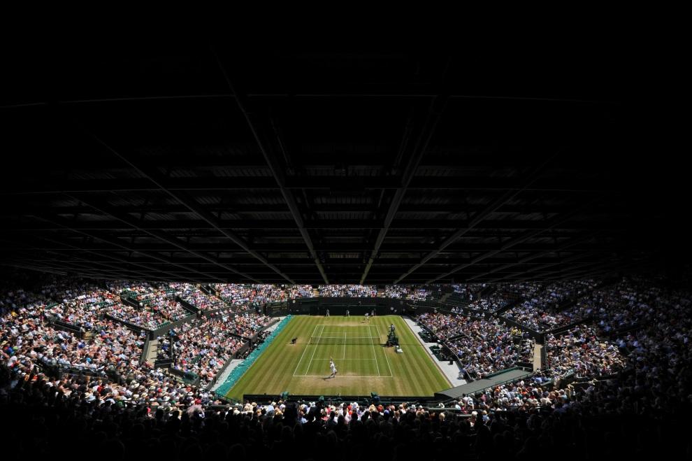 19.WIELKA BRYTANIA, Wimbledon, 2 lipca 2014: Mecz z udziałem Novaka Djokovica i Marina Cilica. AFP PHOTO / GLYN KIRK - RESTRICTED TO EDITORIAL USE