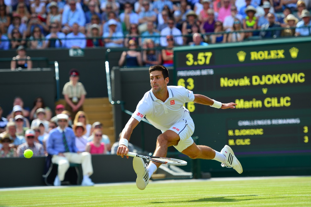 20.WIELKA BRYTANIA, Wimbledon, 2 lipca 2014: Novak Djokovic podczas występu na Wimbledonie. AFP PHOTO / CARL COURT - RESTRICTED TO EDITORIAL USE