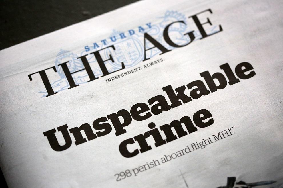 """33.AUSTRALIA, Melbourne, 19 lipca 2014: Zdjęcie okładki gazety """"The Age"""" z tytułem: """"Niwymowna zbrodnia"""". (Foto: Graham Denholm/Getty Images)"""